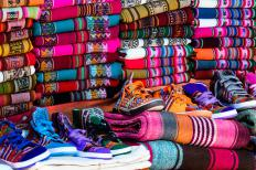 The colorful Guatemalan textiles that are crafted and worn near the ruins of Copan are thought to be similar to the clothing that was used by the ancient Mayan people.