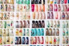 Assortment of artificial fingernails with airbrushed designs.
