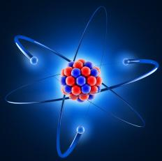 Negatively charged electrons are electrostatically bound to positively charged atomic nuclei.
