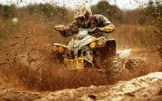 Mud-shedding tires are a common option on sport ATVs.