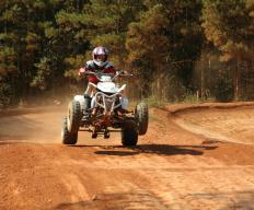 An ATV is a vehicle designed for driving on all types of terrain, including grass and dirt.