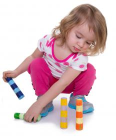 A reward chart might include rewards for a child who cleans up her toys without being asked.