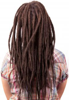 A long curly dreadlocks style offers bounce and femininity to traditional dreadlocks.