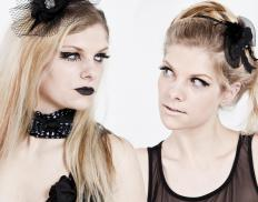 Goth fashion includes clothes that are black or dark-colored clothes that are paired with goth-style accessories and makeup.