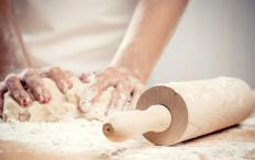 Strudel dough should be kneaded and rolled out on a floured surface.