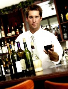 A bartender serving a glass of wine.
