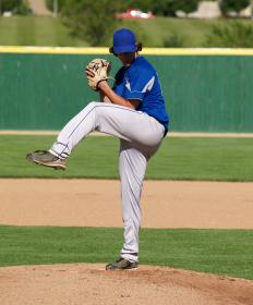 A baseball pitcher throwing during an exhibition game.