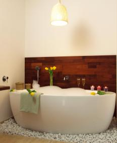 A bath with candles, music, and bubbles can provide a spa atmosphere for very little money.