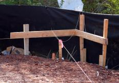 Batter boards may be used to mark the corners and sides of the foundation so that a show block can be installed.