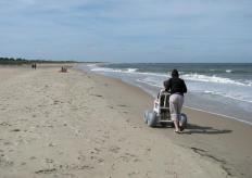 A beach wheelchair is designed to function on sand.