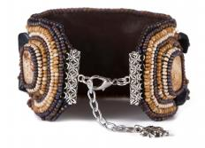 Bead weaving uses tiny seed beads and string to create art as well as wearable items like bracelets.