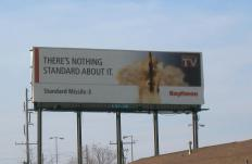 A company can engage in an advertising campaign that results in billboards promoting the company's goods and services.