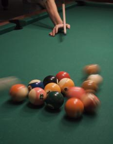 The collison of billiard balls shows elastic scattering.