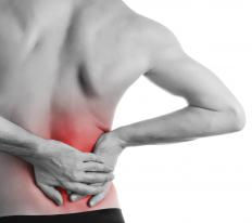 Lumbar radiculopathy is chronic pain in the lower back and legs, which is caused by nerve damage to the lower spine.