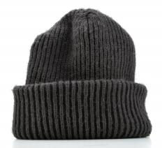 When buying a girl's hat for winter wear, knit or wool hats generally provide the most warmth.