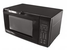 While in a microwave, food will absorb radio waves and the energy translates into atomic motion, which becomes heat.