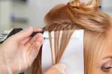 Lowlights and highlights may be done together to create a more natural-looking hair color.