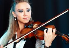 Unlike cellos, violins are held between the performer's left hand and chin.