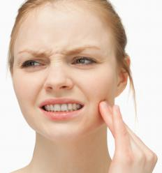 TMJ syndrome may cause tooth and ear pain.