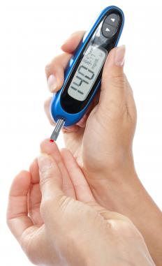 A person checking her blood glucose levels.