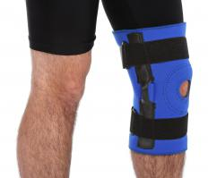 A man wearing a brace for knee hyperextension.