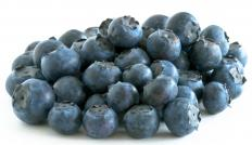 A diet in healthy foods, like blueberries, may help lower cholesterol.