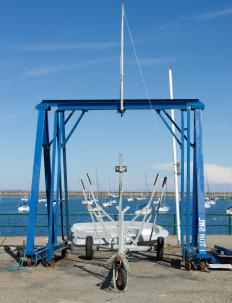A shiplift pulls boats out of the water on a winched platform.