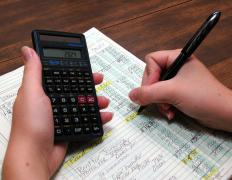 A bookkeeper reviewing a ledger.