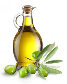 A mechanical press is used to make olive oil from olives.