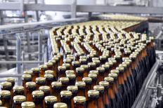 Bottles are moved to crates at a plant, which are then used to move large quantities of bottles to various locations.