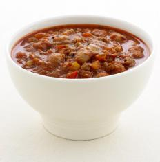 A bowl of chili. Many people like to scoop a few spoonfuls of chili onto their hot dogs.