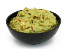 Guacamole can be used as an ingredient in a burrito bowl.