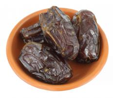 A bowl of medjool dates from a phoenix dactylifera tree.