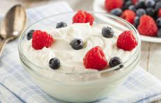 Once the yogurt has fermented, it can be blended with berries or other chopped fruits.