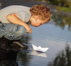 Paper boats are able to float because there is greater force involved with the water pushing up against the boat than the boat pushing down.