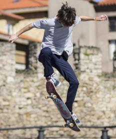 Before attempting a kickflip, a skateboarder must master jumping their board into the air.