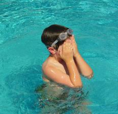 A person uses sound to detect other players in a swimming pool during the game of Marco Polo.