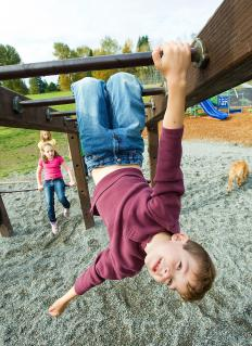 Tanbark is commonly placed around playground equipment for safety.