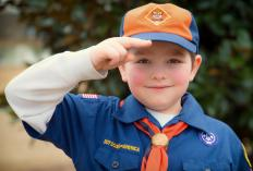 Neckerchiefs have been part of the Boy Scout uniform since 1915.