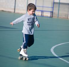 Roller skates have round stoppers positioned at the front for breaking.