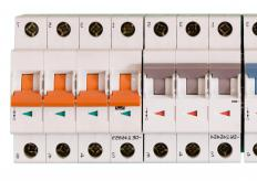 Circuit breakers prevent shortages by mechanically breaking the circuit when an overload is detected.