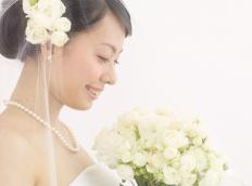 Artificial flowers may be used in wedding bouquets.