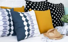 Throw pillows can be used to decorate a dorm room.