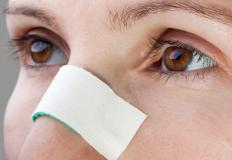 Wax strips can help remove hair on the nose.