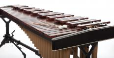 A brass band commonly has one to three percussion members, such as marimba players.