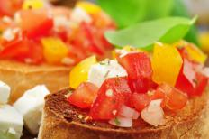 Tomato and pepper bruschetta from a catering platter.