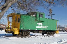Though most caboose were painted red to increase their visibility, some bore the livery colors of their rail line.