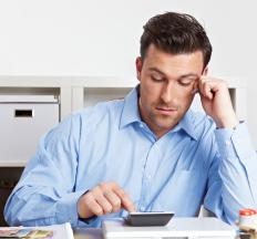 An accountant calculating the invoices of a business.