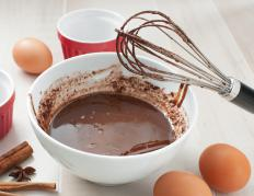 Chocolate pots de crème are cooked in individual ramekins in a hot water bath.