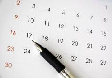 Receptionists often make appointments for clients using a calendar.